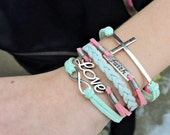 5 Strand Mint, Pink, and Baby Blue Infinity, Faith, Love, Cross Bracelet - 5 Strand Leather Braided Wrapped Cross Bracelet