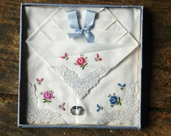 Three unused, boxed, hand embroidered cotton handkerchiefs made in N. Ireland