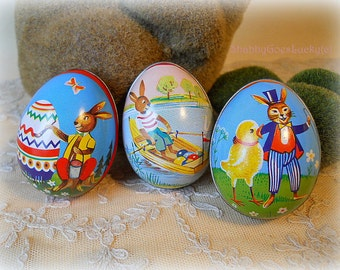 Three vintage tin eggs, small old unmarked lithographed egg shaped tin boxes, shabby old Easter gift or decoration, candy container