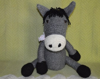 Crocheted girl donkey cuddle toy
