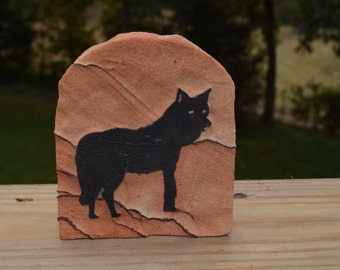 Solid Rock Stone Statue With A Carved Raised Wolf  On It
