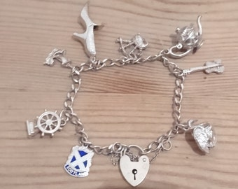 Vintage sterling silver charm bracelet with eight charms
