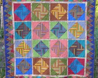 Diamond stripes lap quilt