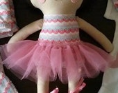 Doll with brown hair and pigtails + tutu and slippers kit