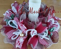 Pretty Winter/Christmas table centerpiece/candle ring.  Burgundy,  cream and natural jute burlap mesh.
