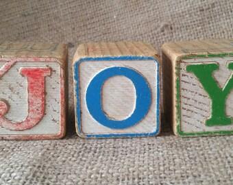 Three vintage wooden child's alphabet/number blocks
