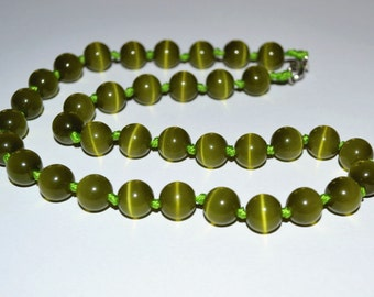 Beads cat's eye 10 mm. Strand of beads green olive cat's eye.