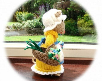 Hand knitted mouse, flower seller, holding basket of flowers, wearing mob cap and apron,pin cushion
