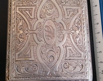 Old finely engraved cigarette case and sapphire embedded