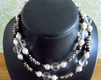 Pretty, vintage necklace, comprised of Black, gleaming gold, clear & pearl beads