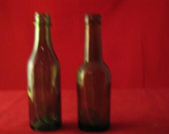 Two miniature beer bottles