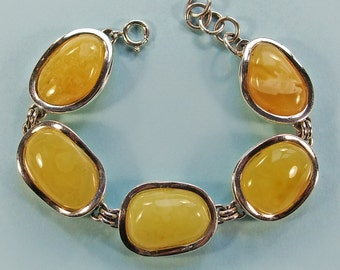 Genuine Baltic amber sterling silver bracelet .