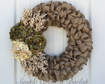 Last one! Charming burlap wreath accented with a peony, hydrangea and cream floral spray. Beautiful Fall burlap wreath
