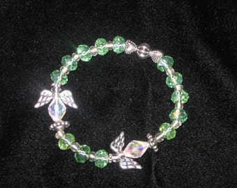 Clear green faceted rondel  crystals with silver bead accents and two angel stretch bracelet