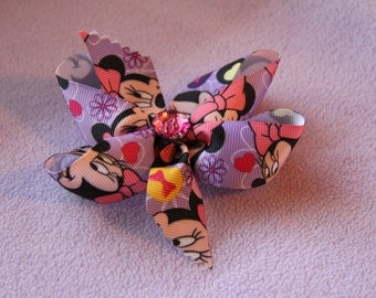 Purple Minnie Mouse Bow with Pink Button Bow
