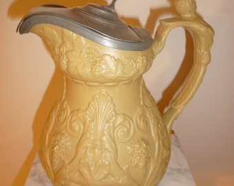 Antique figurine pottery pitcher with pewter lid - circa 1860