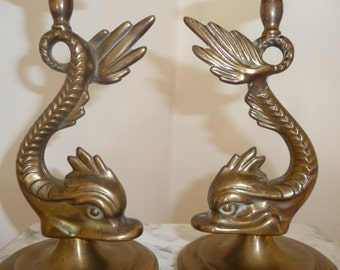 Pair of brass dolphin candle sticks – circa 1920