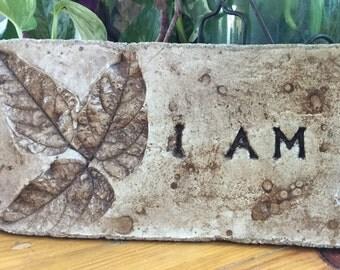 "10 1/2 x 4 1/2. Rustic concrete garden stone. "" I AM """
