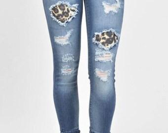 Leopard print distressed skinny jeans