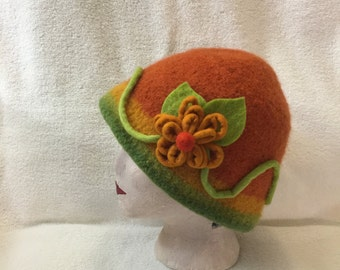 Womens orange, yellow and green wool felted hat with flower embellishments