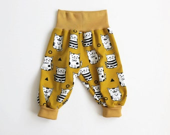 Baby harem pants. Yellow bubble pants with cute cats. Comfy slouchy infant pants with yellow fold over waistband and cuffs.