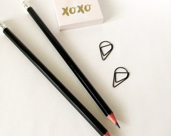 Solid black pencil with white rubber end