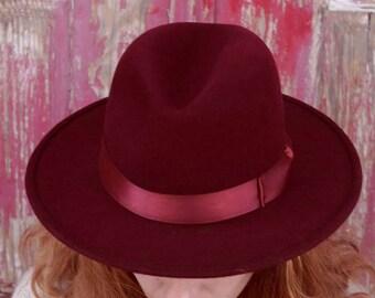Bordeaux Homburg hat with wide rigid flat brim, satin band