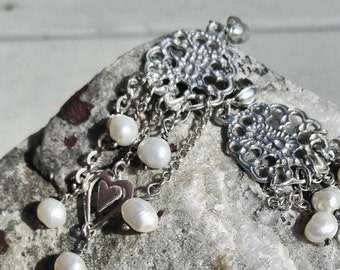 Silver earrings with fresh water pearls.