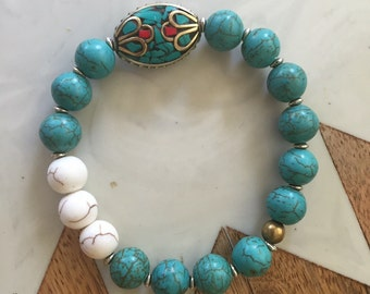 Turquoise and white howlite beaded bracelet with Tibetan bead detail