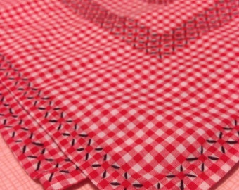 Gingham red and white pucnic/table cloth with black pick stitching