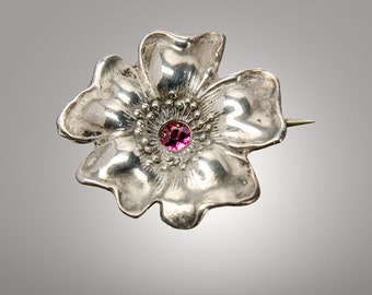 Unger Brothers sterling Dogwood watch pin with red stone center