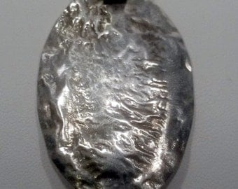 A reticulated silver pendant (5)