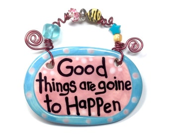 Good things are going to happen pink ceramic sign