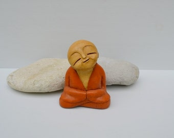 Monk sculpture - Orange, beige and brown - meditating - smiling - spiritual - buddha - meditation