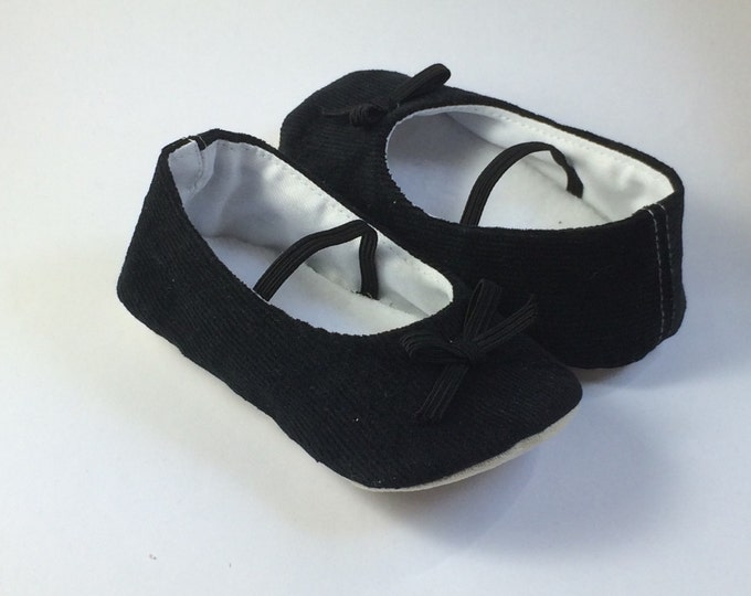 Black cord ballet flats. Soft sole baby shoe, with a dainty little bow on the front