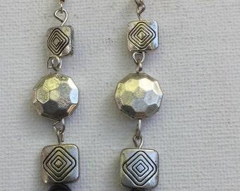 Ornate Tibetan and onyx bead earrings
