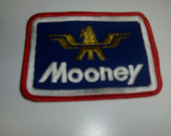 Vintage 4 inch Mooney airplane badge