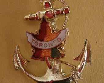 B508) A lovely vintage gold tone metal enamel maple leaf Canada Toronto lucky anchor souvenir badge brooch