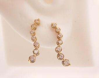 0.20 Carat T.W. Round Cut Diamond Journey Earrings 10K