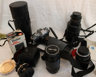 Minolta X-370 35mm Camera System with 5 Lenses, Vivitar Flash and Cambridge Bag