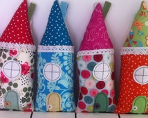 Handmade Scandinavian style houses in fun, contemporary fabrics.