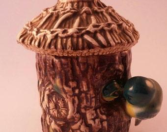 Vintage honeypot tree trunk birds