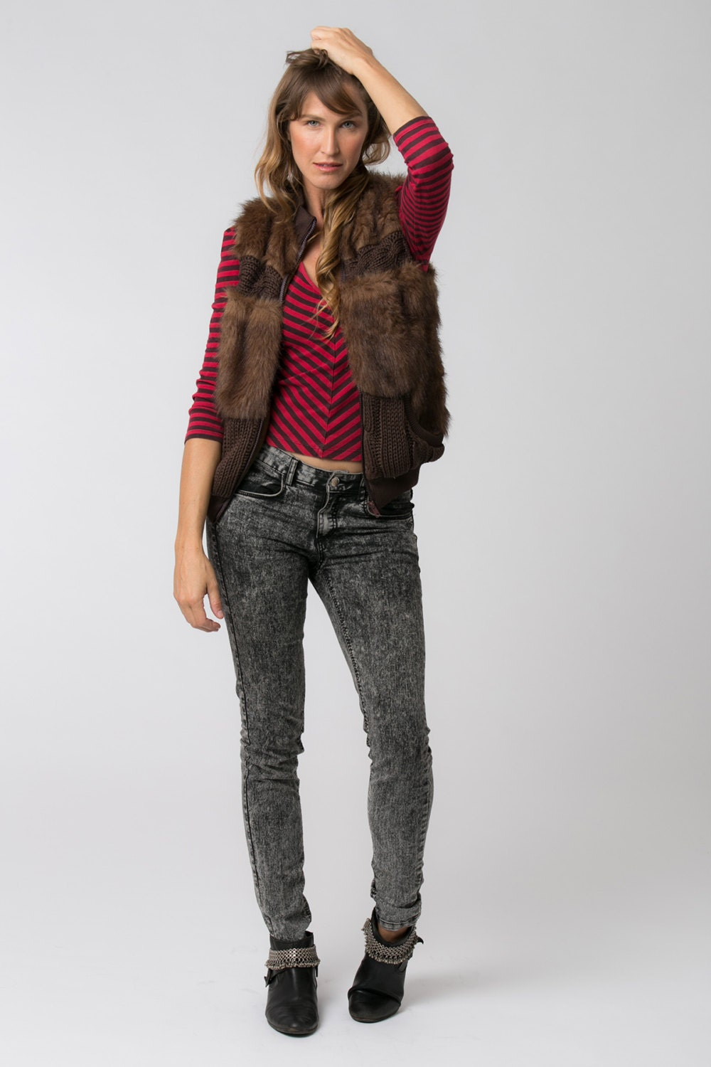 This stylish vest from Mo-Ka is constructed of percent vegan fur and includes two handy front pockets. A faux leather belt and a snap closure completes the timeless look of this vest. Color: Brown.