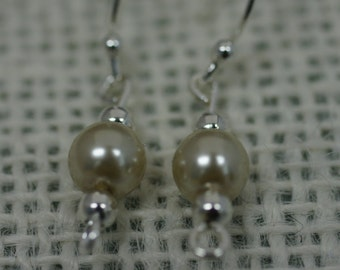 Single faux pearl fish hook earrings with silver accent beads