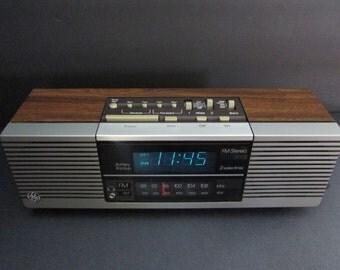 1970's GE Woodgrain Alarm Clock Radio 7 4845 A/ General Electric Digital Dual Alarm AM/FM Clock radio/ Blue Digital Display. Sounds Great.