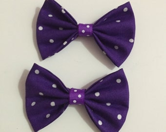 Purple polka dot fabric hair bow