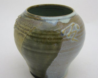 Small stoneware vase, wheel-thrown with slip -trail decoration, with overlapping glazes