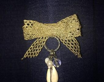 Golden ribbon brooch/bow pin