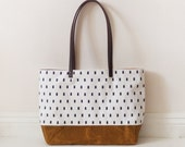 Black line on white waxed canvas tote bag with leather handle