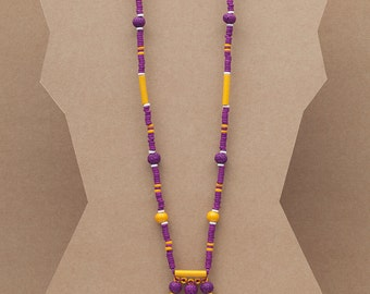 Long beaded necklace with fringe detail made with colour ceramic beads